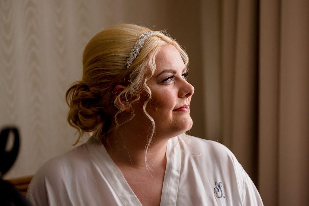 bridal makeup bride looking out window Best Western Marks Tye