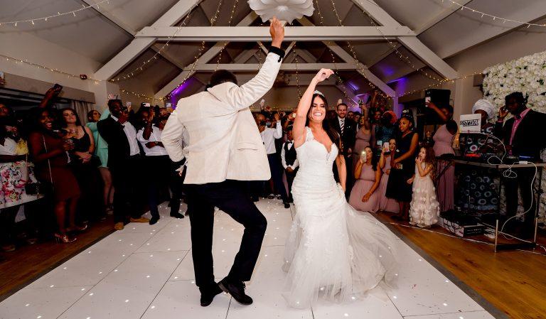 energetic bride and groom dancing together Essex Wedding