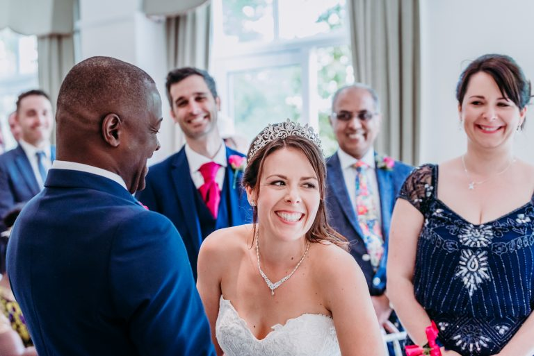 bride laughing during wedding ceremony at Pontlands Park in Essex