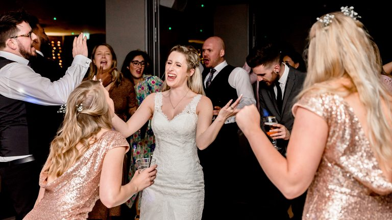 bride dancing and signing with her wedding guests Norfolk Mead Hotel