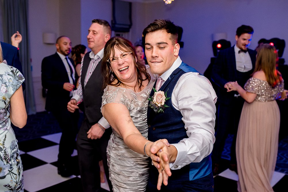 groom dancing with his mum Wotton House