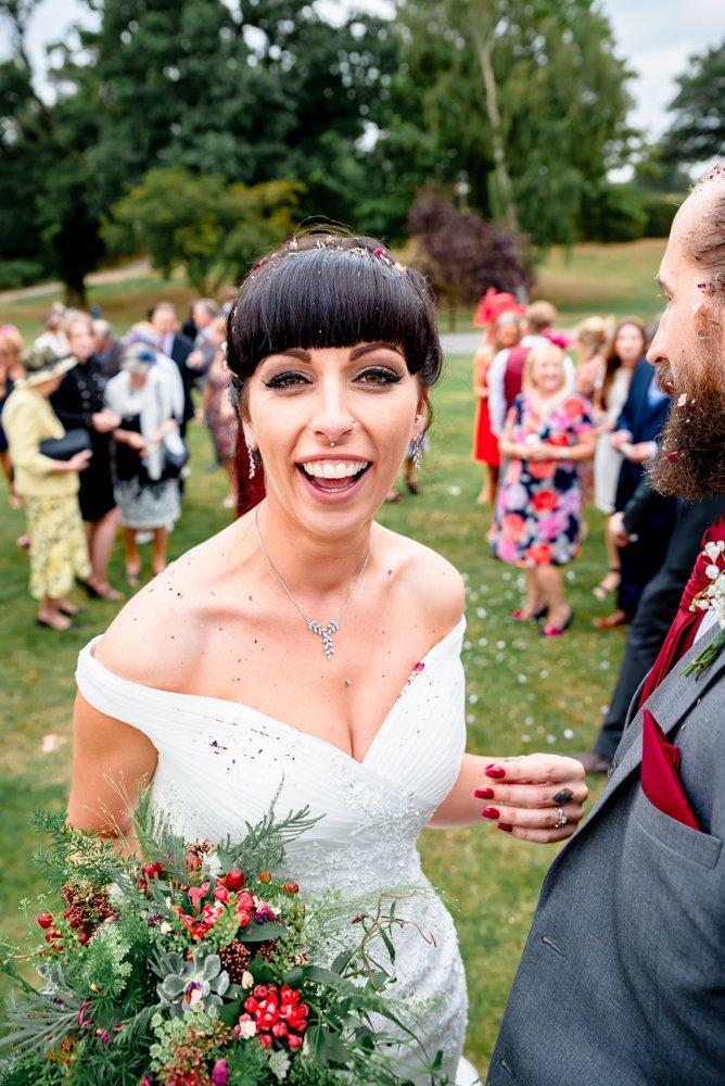 bride covered in confetti The Warren Estate in Essex