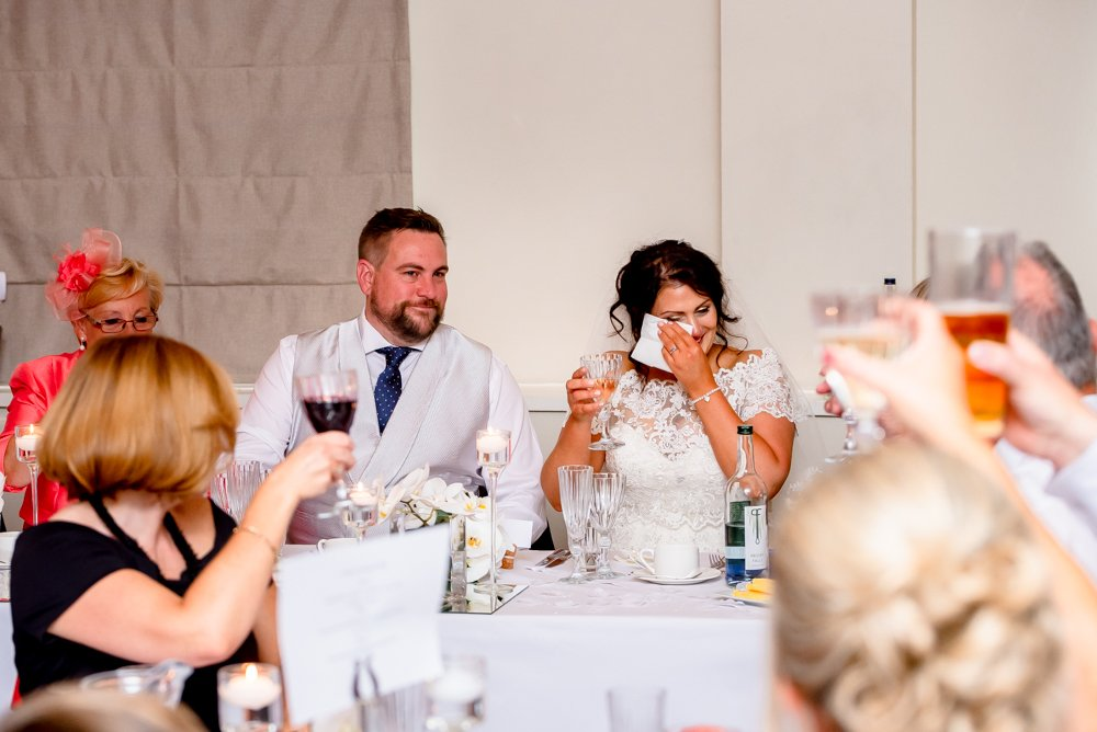 bride crying during wedding speech at Stoke Place