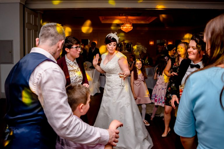bride dancing with wedding guests