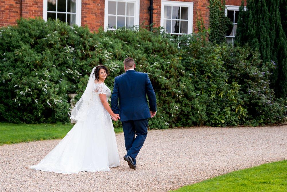 bride groom walking towards Stoke Place
