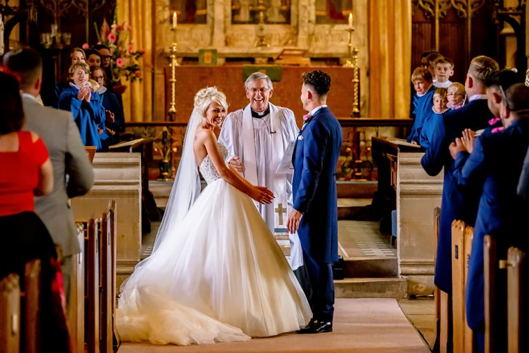 Essex church wedding bride laughing during ceremony