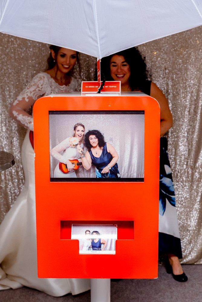 bride using wedding photo booth at Smeetham Hall Barn