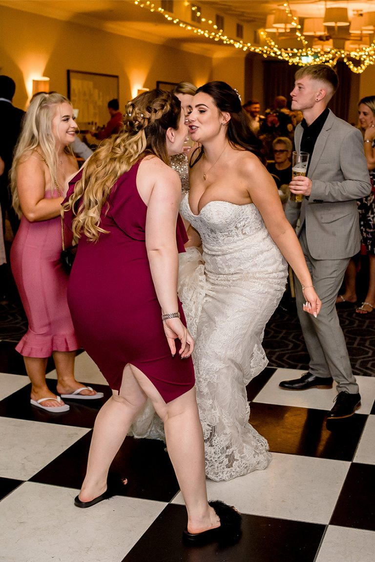 bride dancing with her guest at Essex wedding
