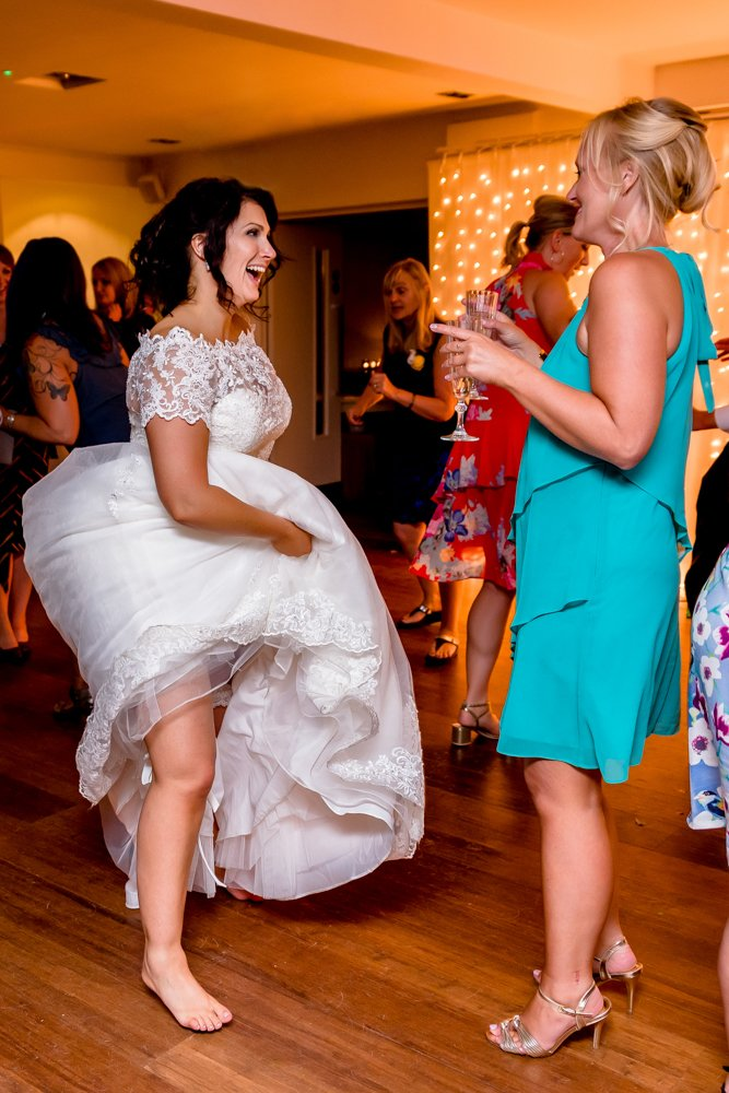 fun bride dancing bare foot at Stoke Place