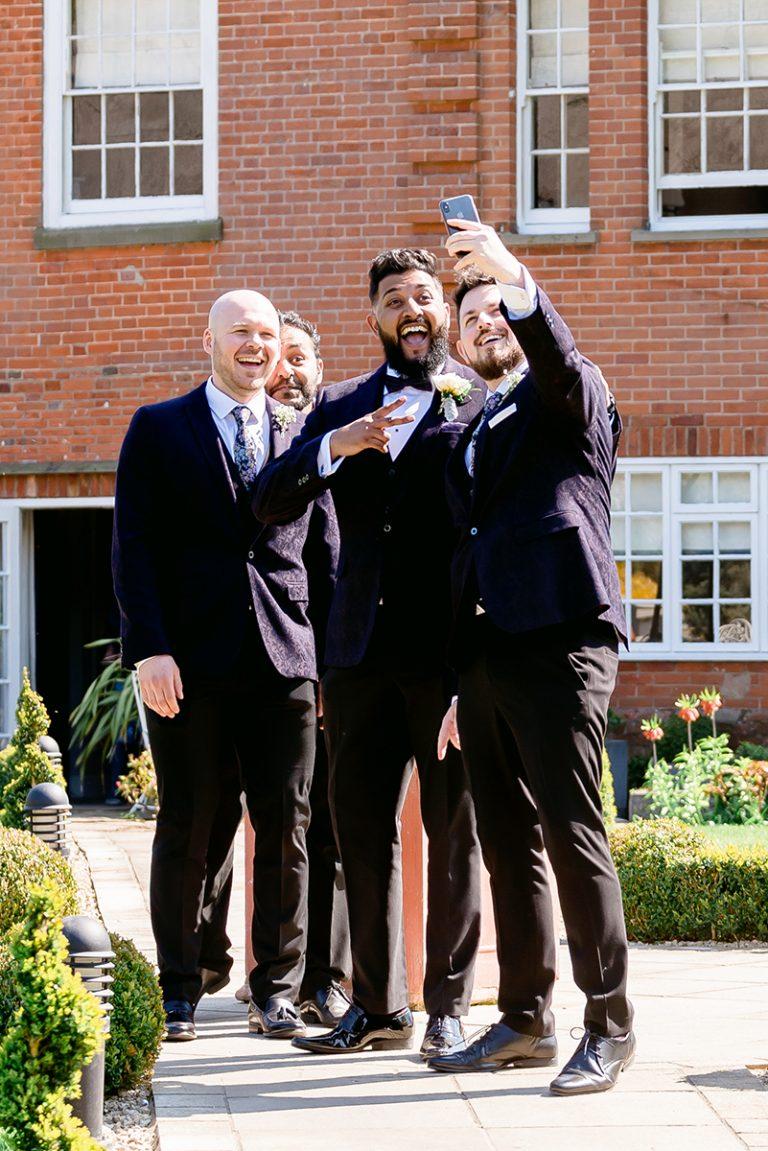 fun groom wedding selfie at Norfolk Mead