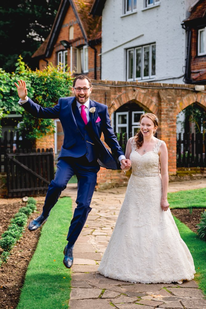 groom jumping for joy