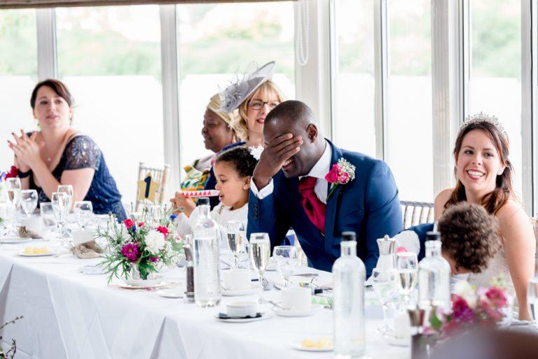 groom laughing at best man speech at Pontlands Park in Essex