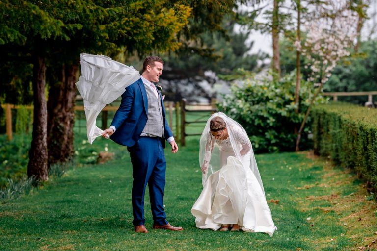 groom swinging brides wedding dress hoop at Smeetham Hall Barn