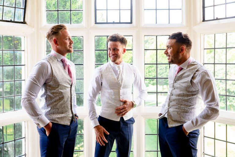groom with ushers laughing