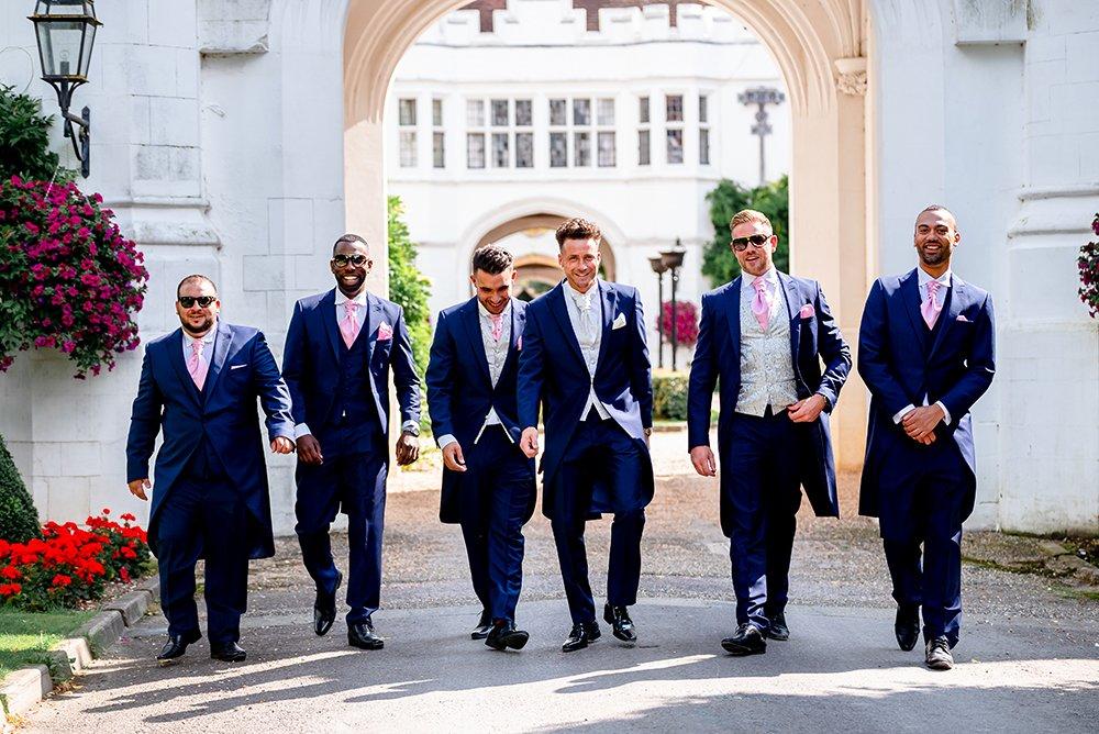 groom with ushers walking toward camera