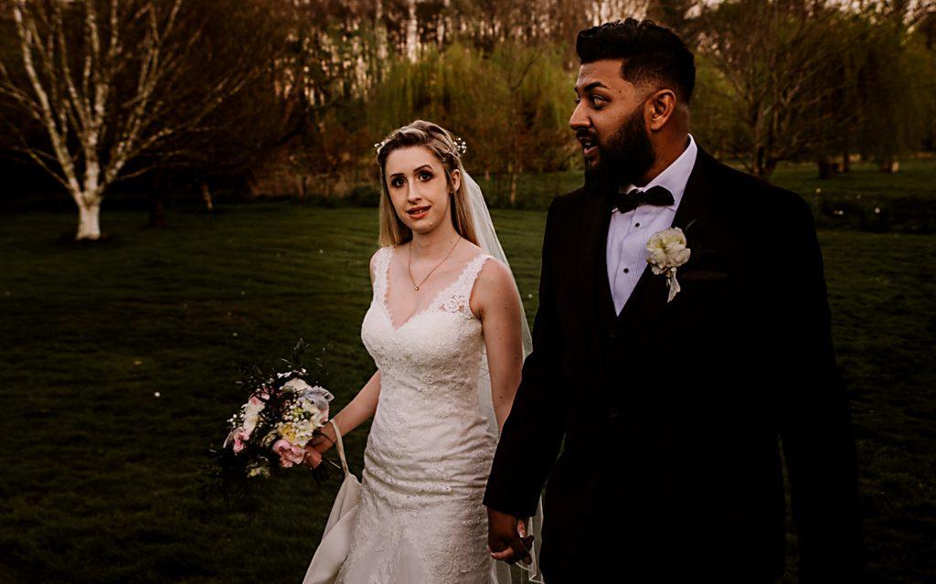bride and groom walking together at Norfolk Mead Hotel
