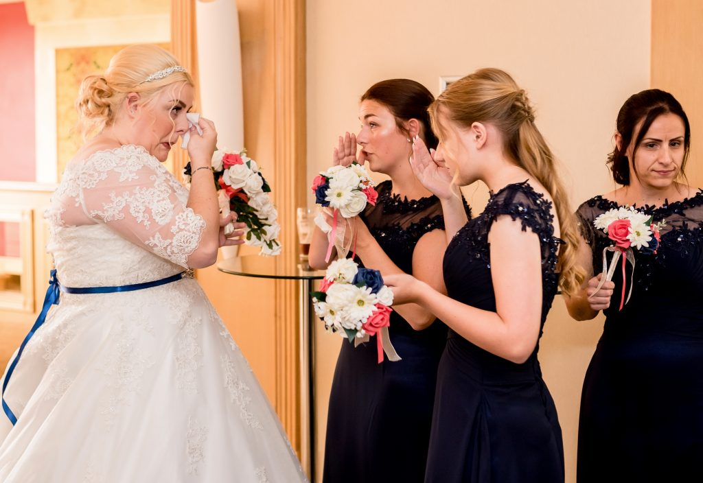 bride and bridesmaids crying after wedding ceremony Best Western Marks Tye Essex