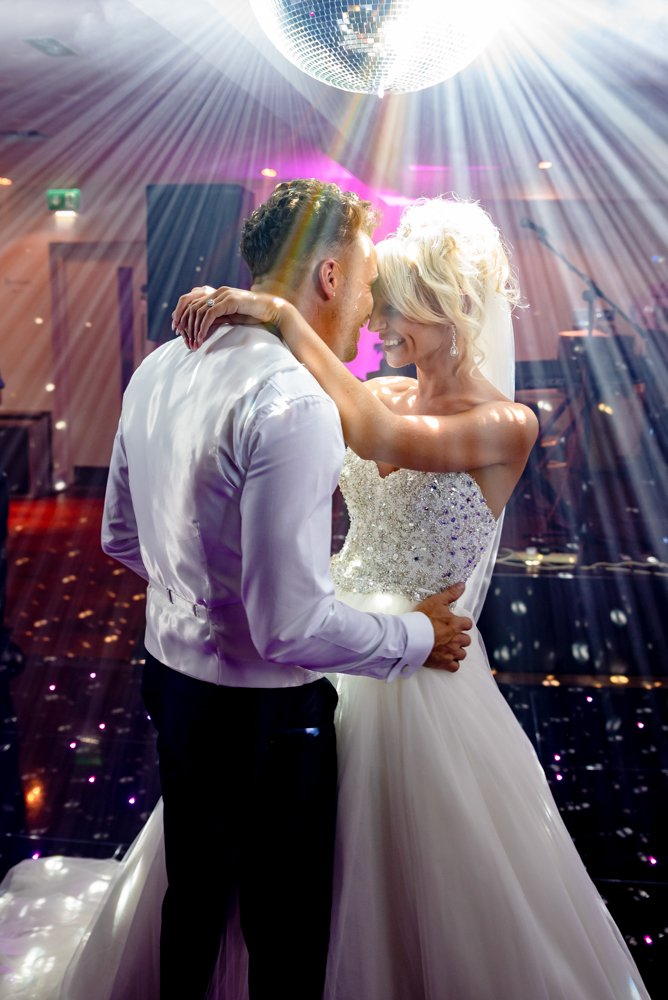 bride and groom first dance with strobe lighting
