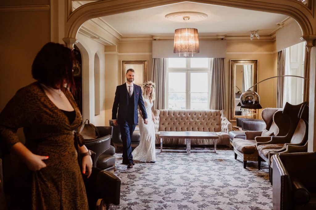 bride and groom walking down the aisle Maison Talbooth Essex wedding photography