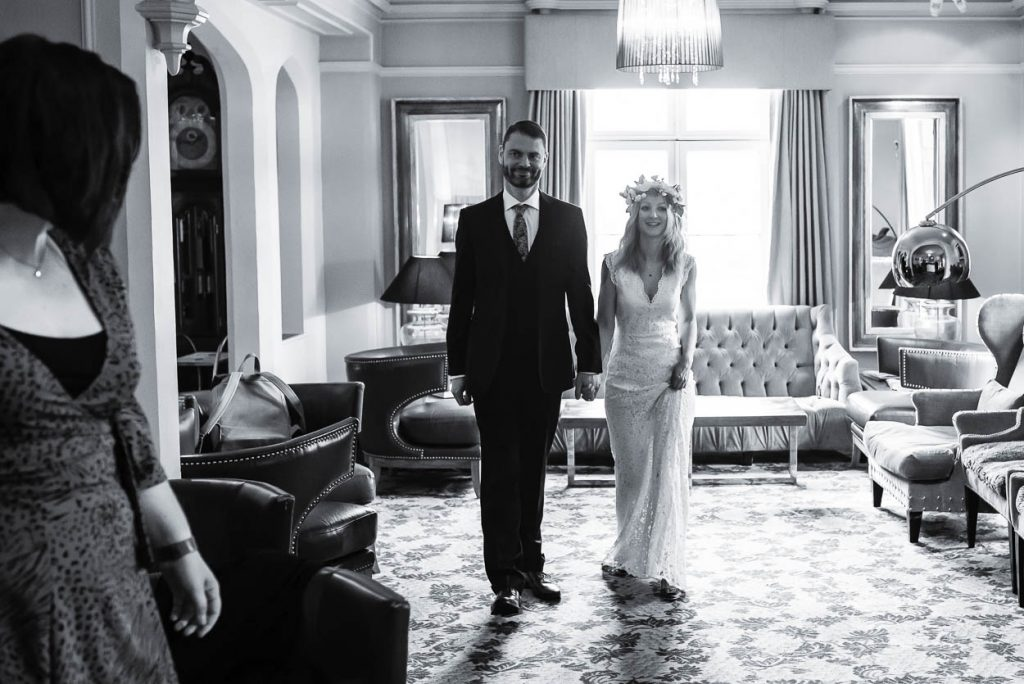 black white photo of bride and groom walking down the aisle Maison Talbooth Essex wedding photography