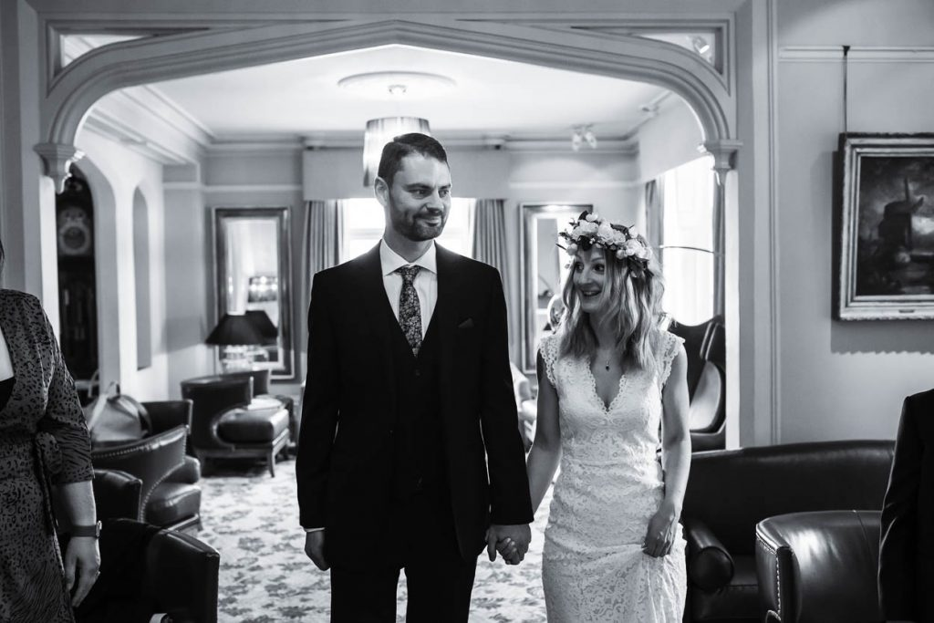 bride and groom laughing during ceremony Maison Talbooth Essex wedding photography