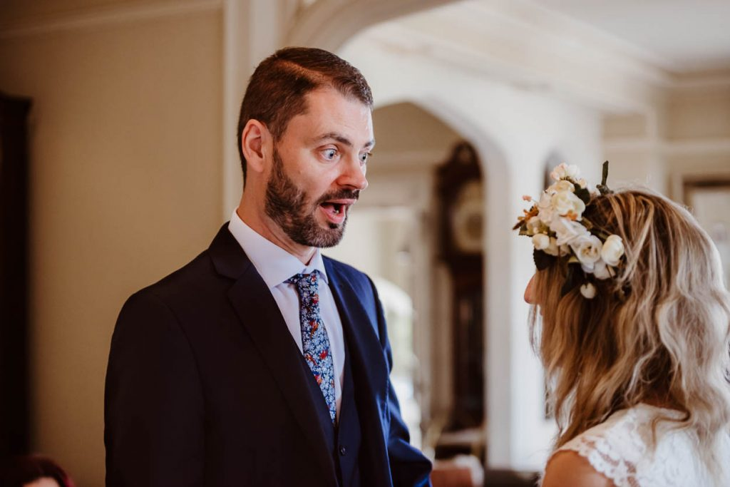 groom shocked as his phone goes off during wedding vows Maison Talbooth Essex wedding photography