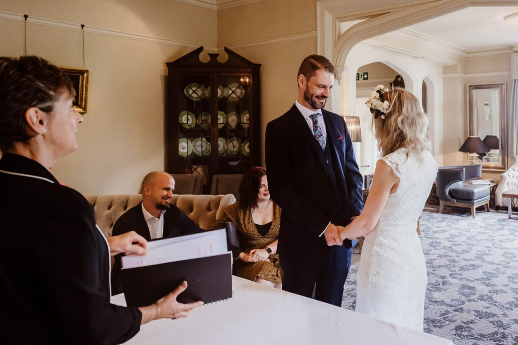 bride and groom holding hands during wedding ceremony Maison Talbooth Essex wedding photography