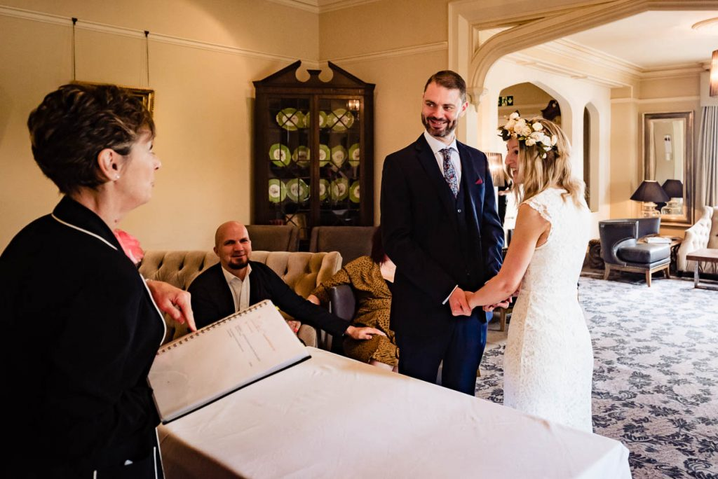 wedding couple saying their vows Maison Talbooth Essex wedding photography