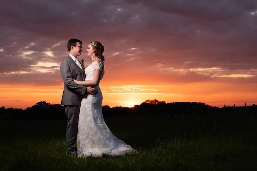 bride and groom photo at sunset Newland Hall Alternative Essex Wedding Photographer